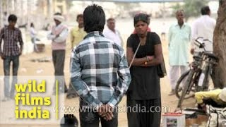 Young girl showing stunts with iron rod at Pushkar fair, Rajasthan