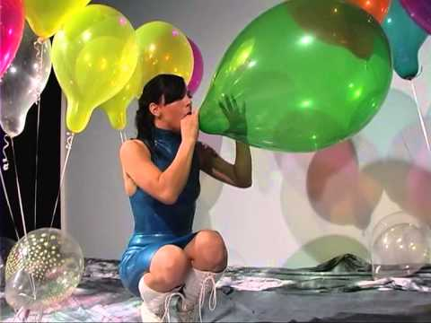 sexy women popping balloons