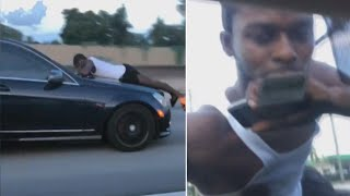911 Call of Man Clinging to Car Hood: 'Someone's Trying to Steal My Car'