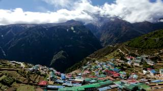 preview picture of video 'Time-lapse of the colorful mountainside village Namche Bazaar.'