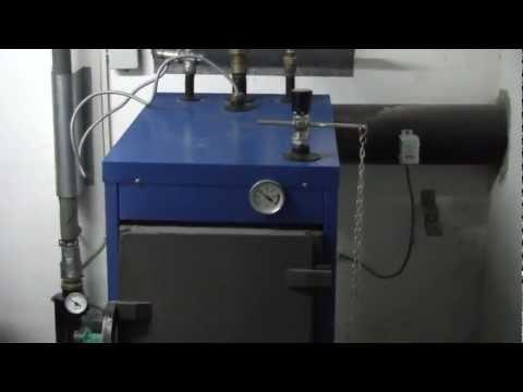 Scheitholzkessel NMT15 Pufferspeicher Laddomat Festbrennstoffkessel 1/2