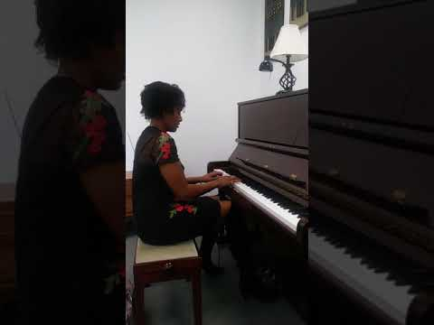 Playing piano by memory/ear.