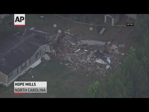 A single-engine plane crashed into a North Carolina home, killing the pilot and someone inside, authorities said. Another person in the house was seriously hurt. (June 28)