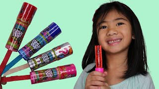 Toddlers Learn Colors with Push Pop Candy