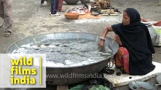 Indian woman sells fish in huge container: Fish Market in Bihar