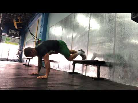 Plank with Feet Elevated & Knee Tuck