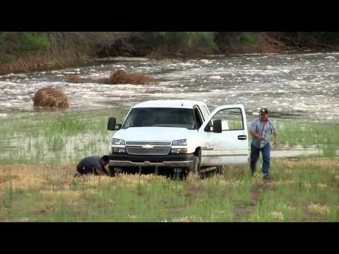 Truck Gets Stuck In River Bed As Water Rises