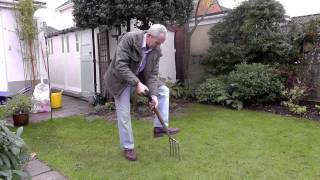 Amateur Gardening video: Tim spiking lawn