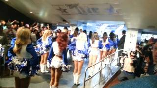 Dallas Cowboy cheerleaders leading the team out of the tunnel
