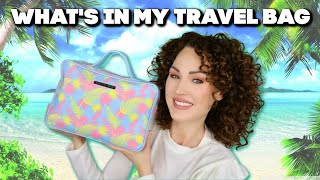 WHAT'S IN MY TRAVEL BAG , CURLY HAIR EDITION   The Glam Belle