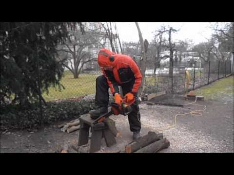 Overallblondy in Skioverall with chainsaw