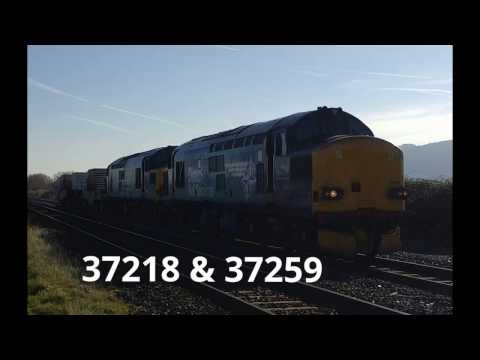 DRS 37218 & 37259 pass Prestatyn with horns working the Vall…