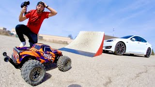 RC TRUCK JUMP OVER A TESLA.