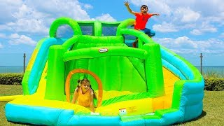 Ali and Adriana play with Inflatable water slide