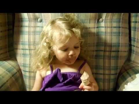 Little Girl Eating Ice Cream Cone ~ Messy Chocolate Face