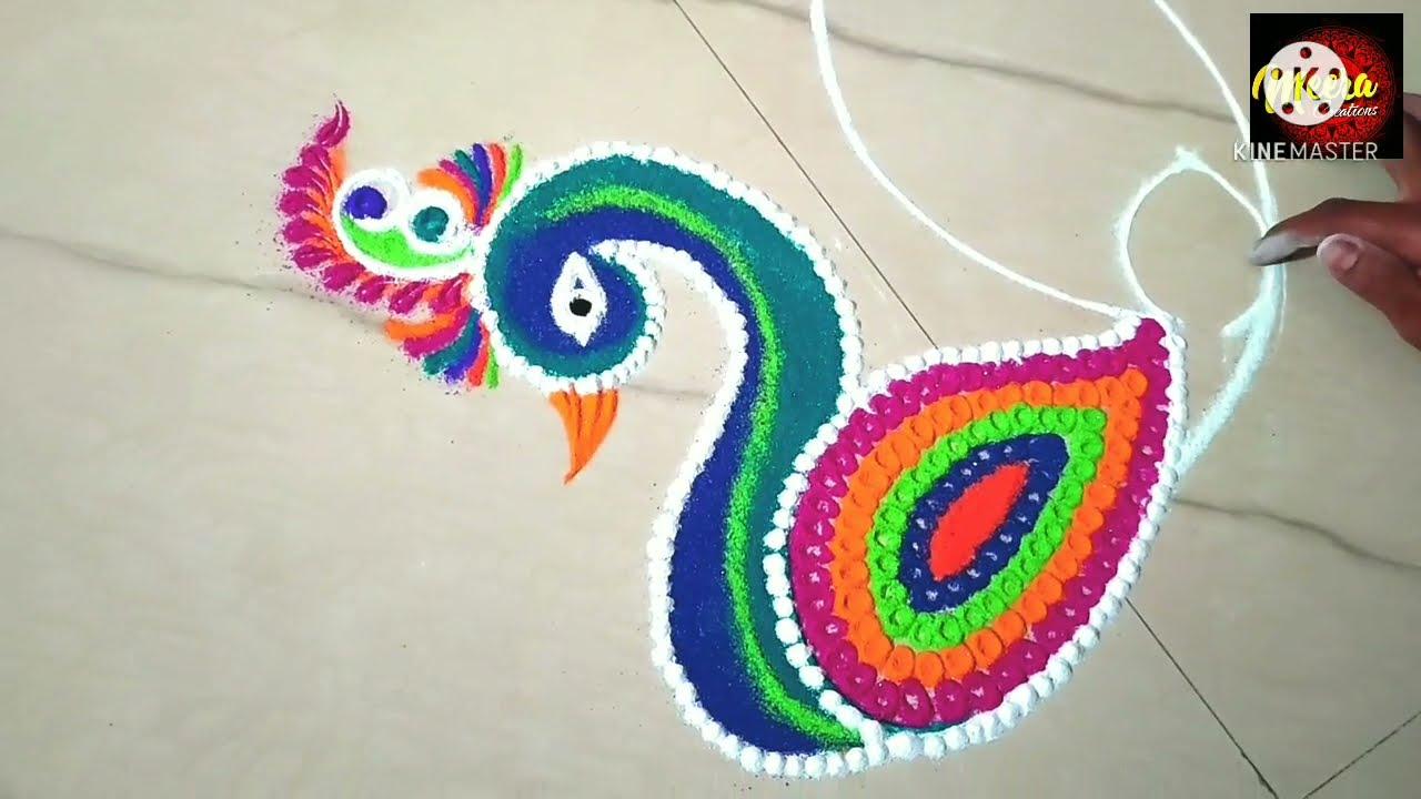 beautiful peacock rangoli design by meeras creation