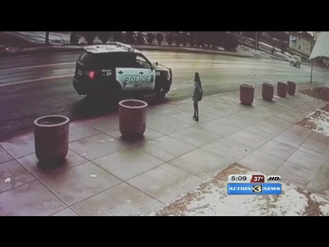 OPD Officer Gives Kid a Winter Hat