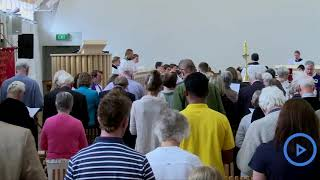 People pray at Christchurch's Cardboard Cathedral for the victims