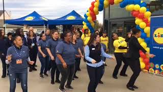 Employees dance prior to first Lidl store opening