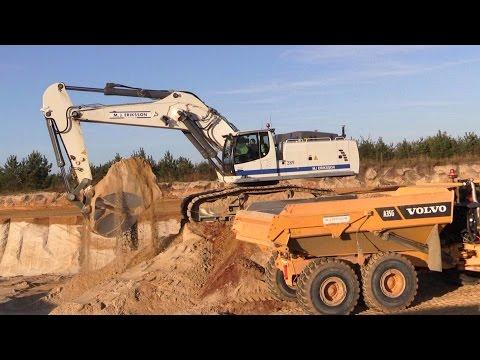 Liebherr R970 Super Mass Excavator Loading Volvo A35G Dumpers