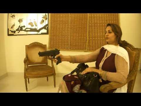 114. Woman with gun (Hindi)