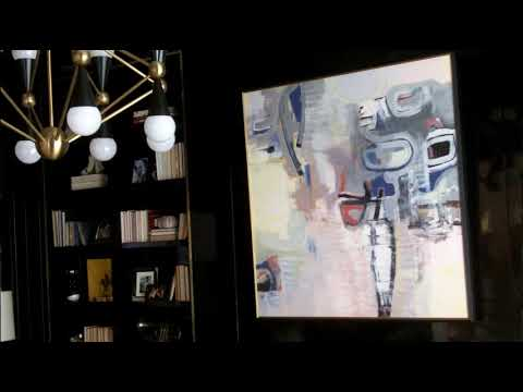 Lighthouse Technologies: Hidden TV Behind Art (In the Den)