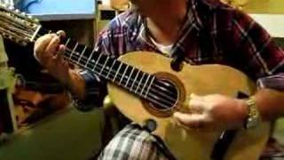 My dad playing the cuatro, Puerto Rico's national instrument