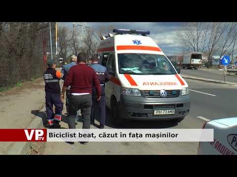Biciclist beat, căzut în fața mașinilor