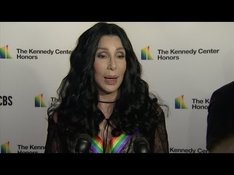 "At the Kennedy Center Honors in Washington, this year's recipients - including Cher, Reba McEntire, and the ""Hamilton"" team - react to being recognized for their work, while past winner Gloria Estefan gushes over Cher and Reba. (Dec. 3)"