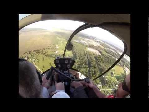 Helicopter pilots witness an RC plane crash and initiate recovery from tree tops
