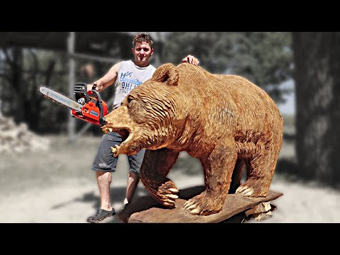 wooden sculpture of a bear using chainsaw by vlad