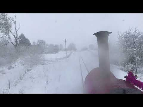 On the footplate of Maid Marian as she battles the snow on t…