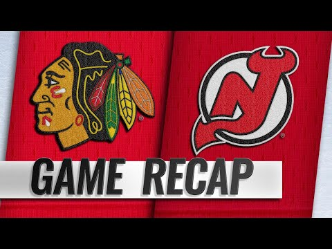 Devils erupt for eight goals to down Blackhawks