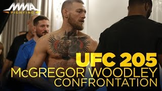 Conor McGregor, Tyron Woodley Share Moment at UFC 205 Weigh-Ins