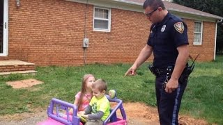 Police Officer Dad 'Pulls Over' Kids in Power Wheels, Gets Funny Reaction
