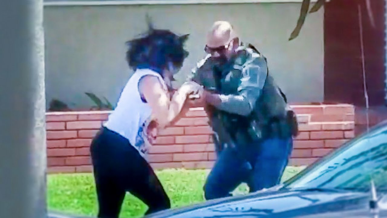 Woman Recording Cop Activity Gets Cell Phone Aggressively Taken And Destroyed thumbnail