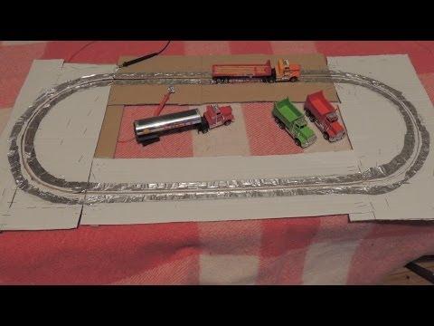 Tyco slot cars trucks & lorries on homemade track of cardboard, aluminum foil & staples