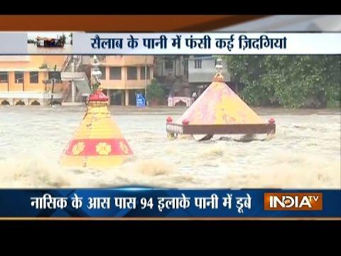 , title : 'Heavy Rain and Flood Strike Nashik District, Godavari River Bursts its Banks'