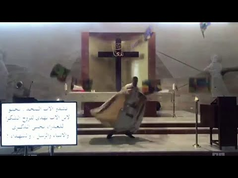 Crazy: Priest runs for cover as Beirut shockwave hits during mass