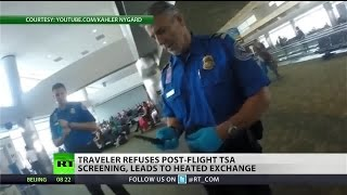 TSA officers try to screen passenger after his flight, threaten him after refusal