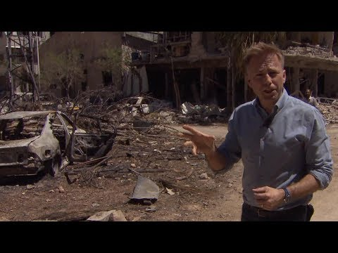 CBS News travels to ruins of coalition strikes on Syria