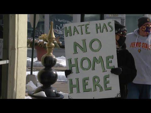 Residents protest KKK flag displayed in Grosse Pointe Park home facing Black neighbor