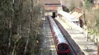 preview picture of video 'Central line tube train arriving and then leaving Chigwell'