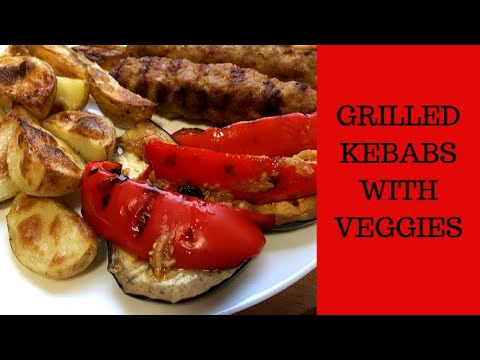 Kebabs and veggies on grill at home. Tasty and easy recipe