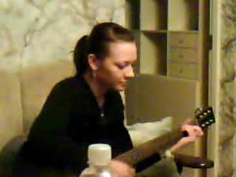 """Maya playing guitar and singing """"Es Aiziet Nevaru"""""""