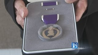 Purple Heart medal given to family