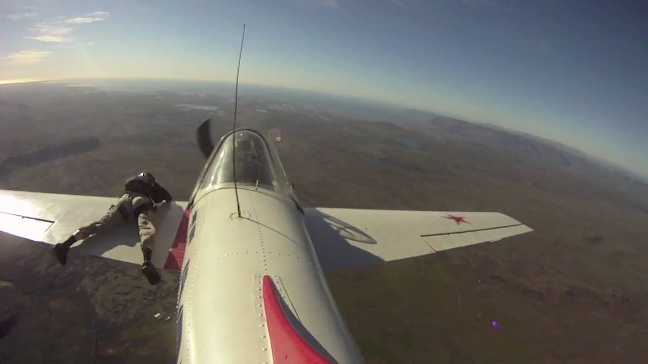 Watch This Aircraft Rolling With A Man Holding To The Edge Of Its Wing