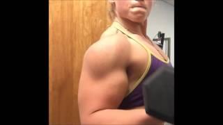 Muscle girl training big biceps