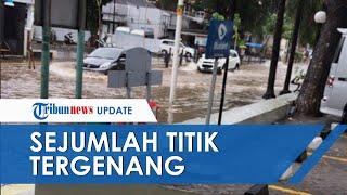 Genangan Air Terlihat di Sejumlah Titik Jakarta, Sejumlah Petugas Kepolisian Atur Lalu Lintas