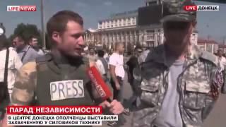 Смотреть онлайн Пленные украинские солдаты идут по улицам Донецка